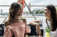 UK, London, two happy women traveling by boat on the River Thames - MGOF03904