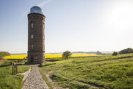 Germany, Ruegen, Cape Arkona, Positioning Tower, Peilturm and rape field in the background - MAMF00259