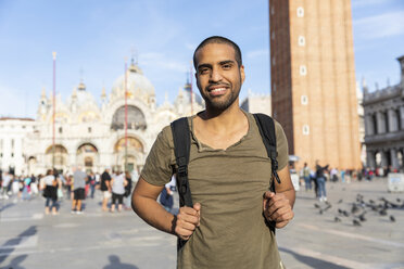Italy, Venice, portrait of smiling young man on St Mark's Square - WPEF01260