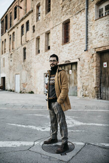 Spain, Igualada, portrait of man standing on the street in industrial zone of the town - JRFF02312