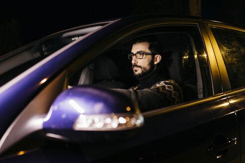 Man driving car at night - JRFF02318