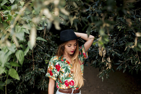 Blond young woman surrounded by leaves and nature - LOTF00026