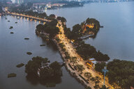 Vietnam, Hanoi, panoramic view of a road between two lakes at dusk with Tran Quoc Pagoda on the right - WPEF01276