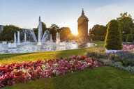 Germany, Mannheim, Friedrichsplatz with fountain and water tower in the background by sunset - WDF05011