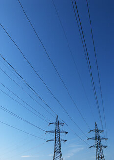 Power pylons under blue sky - WWF04758