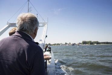 Germany, Ruegen, senior man on Glewitz ferry - MAMF00309