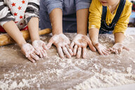 Mother and children with flour on their hands, partial view - JRFF02343