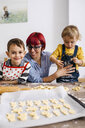 Mother baking cookies with her children - JRFF02349