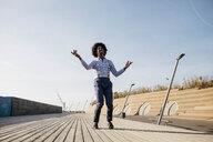 Man dancing on boardwalk - JRFF02419