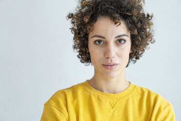 Portrait of confident woman wearing yellow sweater - JOSF02707