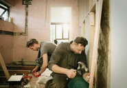 Construction workers working in house - HOXF04269