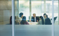 Businessman talking in conference room meeting - HOXF04272
