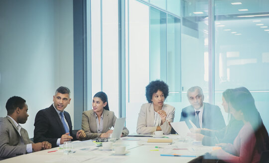 Business people planning in conference room meeting - HOXF04314