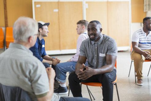 Men talking in community center - CAIF22514