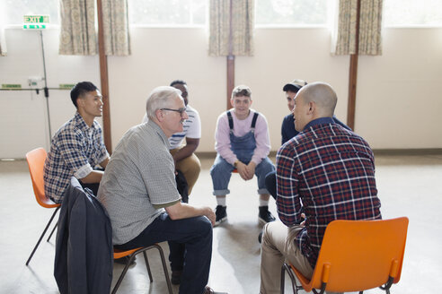 Men talking in group therapy circle - CAIF22541