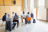 Men talking in group therapy - CAIF22568