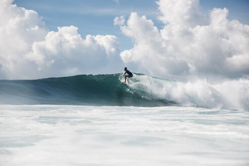 Indonesia, Bali, Serangan, Surfer on a wave - KNTF02589