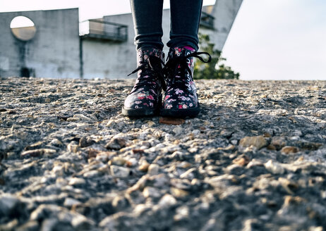 Girl wearing boots with floral design - MGOF03932