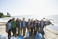 Beach cleanup volunteers on sunny beach - HEROF04116