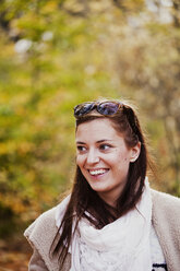 Close-up of smiling woman in forest - ASTF01349