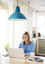 Woman with laptop working at home - HAPF02849