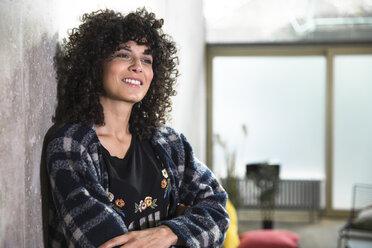 Portrait of smiling woman in a loft - FKF03143