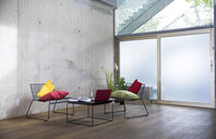 Sitting area in a loft at concrete wall - FKF03155