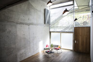 Sitting area in a loft at concrete wall - FKF03206