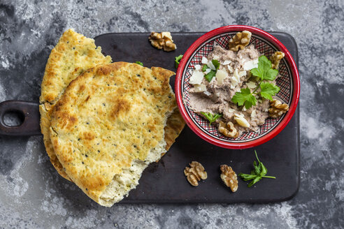 Bowl of homemade aubergine cream with walnuts, parmesan and parsley served with pita bread - SARF04045