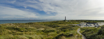 Denmark, Jutland, Skagen, Grenen, dune landscape with lighthouse in background - UMF00907