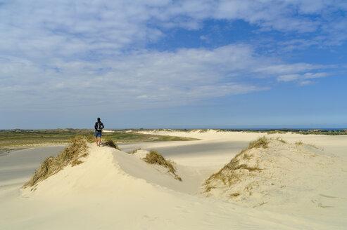 Denmark, Jutland, woman enjoying the view at Rabjerg Mile shifting dune - UMF00910