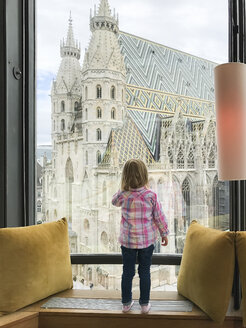 Austria, Vienna, girl looking out of window towards Stephansdom - PSIF00201