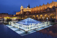 Poland, Krakow, Main Square in Old Town at night, illuminated fountain and Cloth Hall - ABOF00388