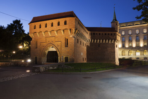 Poland, Krakow, Barbican at night, old city wall fortification, 15th century fortified outpost - ABOF00397
