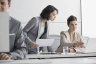 Businesswomen working at laptop in conference room - HEROF04161
