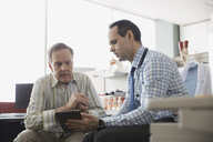 Doctor and senior patient using digital tablet - HEROF04227