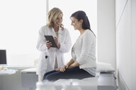 Doctor and patient looking at digital tablet - HEROF04353