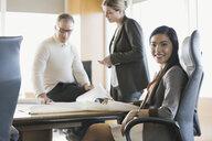 Portrait of confident businesswoman in meeting - HEROF04401
