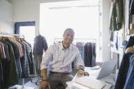 Portrait of confident business owner in clothing shop - HEROF04413