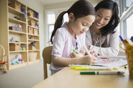 Mother and daughter coloring with markers - HEROF04452