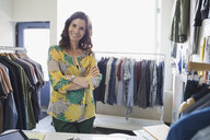 Portrait of confident business owner in clothing shop - HEROF04461