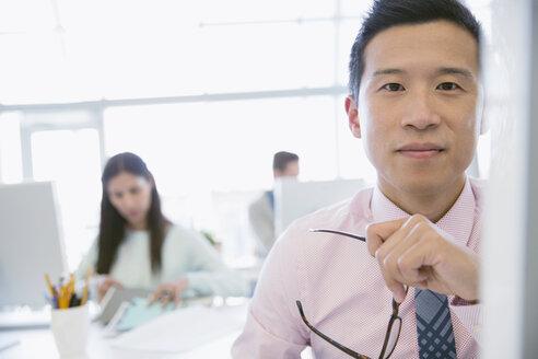 Portrait of confident businessman in office - HEROF04539
