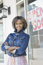 Portrait of business owner standing at new storefront - HEROF04578