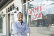 Portrait of business owner standing at new storefront - HEROF04584