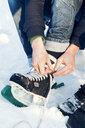 Lacing ice skates in Sweden - FOLF09657