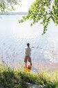 Mid adult man fishing in Svadsjo, Sweden - FOLF09663
