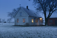 Wooden house in snow at night in Oland, Sweden - FOLF09810