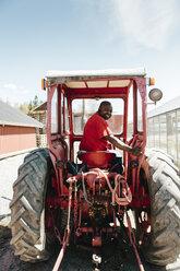 Garden centre worker on tractor - FOLF09912