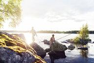 Friends fishing on a lake in Dalarna, Sweden - FOLF10174