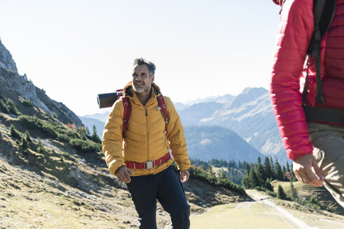 Austria, Tyrol, smiling man with woman hiking in the mountains - UUF16336